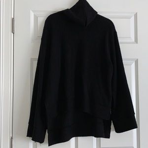 Black thick turtle neck sweater with bell sleeves